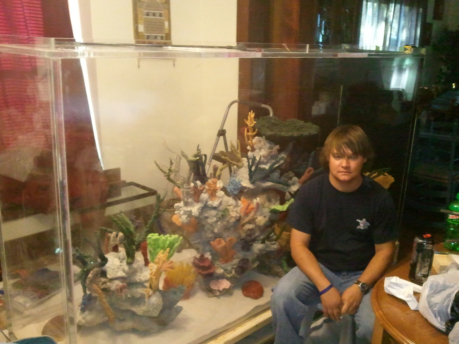 Me next to my uncles 500 gallon saltwater tank | by curtis miller